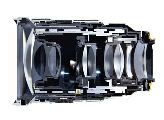 Cut haft cross section camera lens isolated on black background.