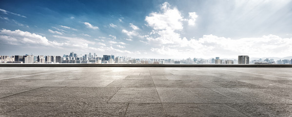 Fototapete - empty floor and cityscape of modern city against cloud sky