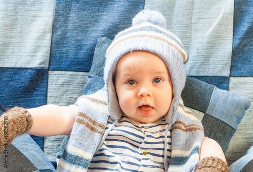 ab5b6696a23 portret funny baby boy in a warm hat