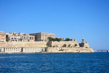 Valletta waterfront buildings seen from across the Grand Harbour in Vittoriosa, Malta.