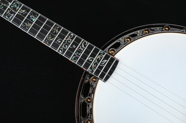 Mahogany banjo luxury gold inlaid with mother of pearl on a black background