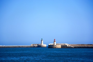 View of the entrance to the Grand Harbour showing the red and green navigation towers, Valletta, Malta.