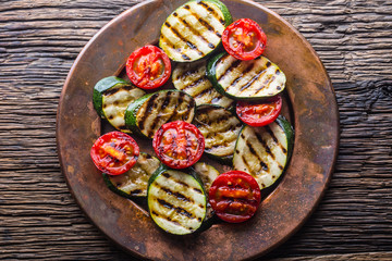 Griledl seasonal vegetable tomatoes and zucchini. Grill food