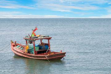 old wooden fishing boat in the sea.