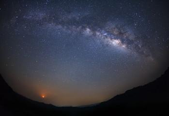 Milky way galaxy and moon light with stars over moutain at Phu Hin Rong Kla National Park,Phitsanulok Thailand