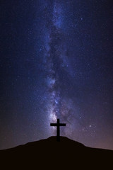 Silhouette of cross and milky way galaxy, Night sky with stars and space dust in universe