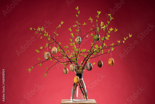 Vase With Tree Branches And Multicolored Hand Painted Easter Eggs