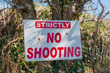 "Sign warning ""strictly no shooting"""