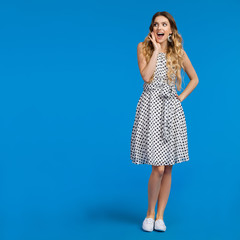 Happy Shouting Young Woman On Blue Background