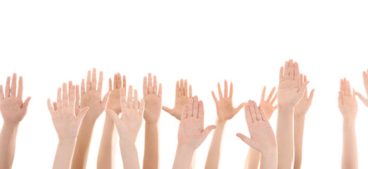 Raised in air hands on white background. Volunteering concept