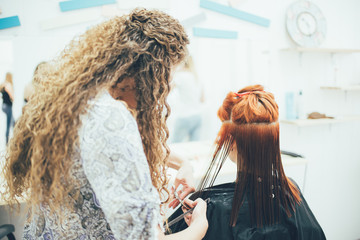Stylist working in the beauty salon, haircut and hair styling