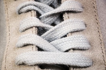 Pair of men's sports shoes close up background