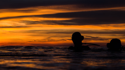 beautiful sky in golden hour when diver floating on the water before start dive