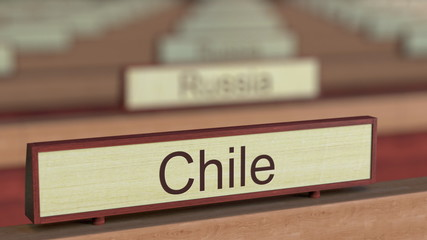 Chile name sign among different countries plaques at international organization. 3D rendering