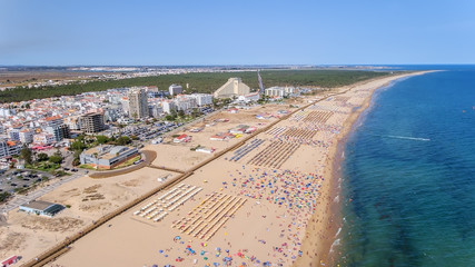 Aerial. Photo from sky of the Monte Gordo beaches, shot from the drone. Portugal, Algarve