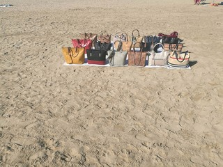 Counterfeit bags for sale on the beach