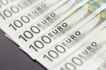 Close-up of 100 Euro banknotes. Shallow dof