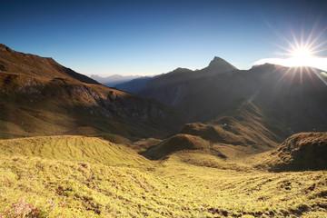 morning sunlight over alpine peaks