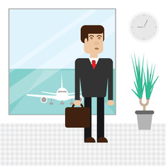 Business man at the airport is waiting for departure. Business trip abroad.