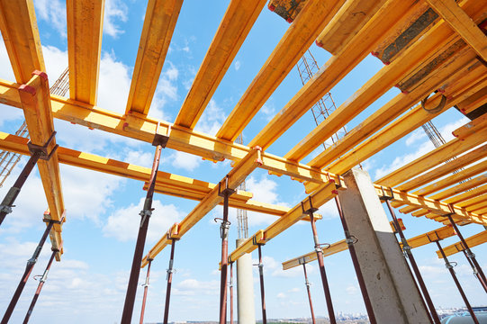 Construction beam falsework for concrete building