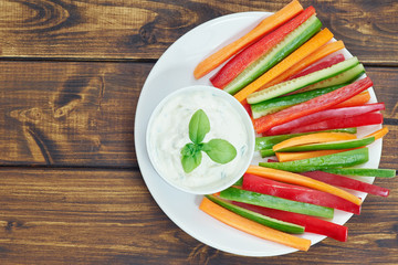 Healthy vegetable sticks on plate with dip