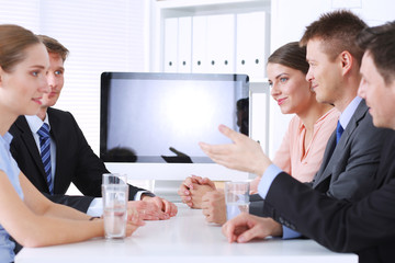 Business people shaking hands after meeting in office.