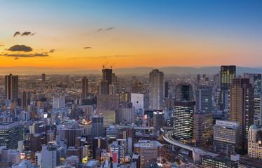 City building downtown with sunset sky background, Osaka Japan