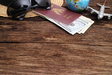 travel concept , Go on an adventure, The world map and the passport and money on a wooden table. Top view.