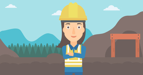 A woman on the background of entrance to the mining tunnel vector flat design illustration. Horizontal layout.