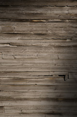 Weathered wooden wall with unpainted planks