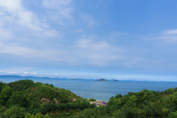 Setonaikai (Seto Inland) Sea and islands under blue sky at Saijo-city in Ehime, Japan