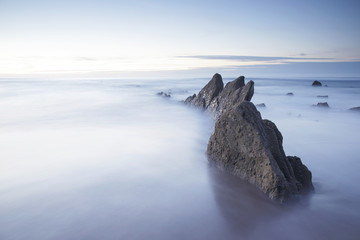 Serene seascape in Barrika beach, Biscay, Basque Country, Spain. Long exposure shot. Wall mural