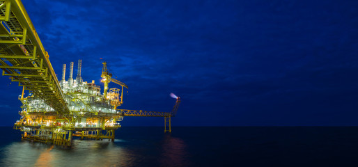 Offshore oil and gas central processing platform in the gulf of Thailand in twilight panorama scene.