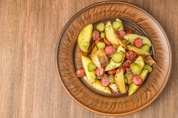 German potato salad with bacon and sausages. The view from the top. Copy-space.
