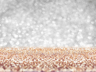Abstract gold floor and silver wall glitter blur background studio room with bokeh lights,Sparkling backdrop for display or montage of product in holiday seasonal concept.