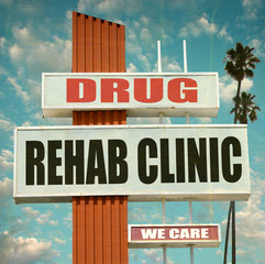 aged and worn vintage photo of drug rehab clinic sign