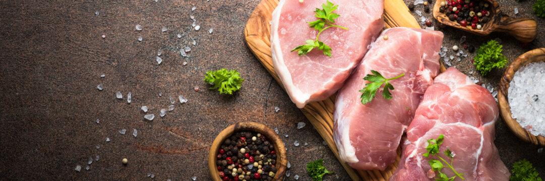 Fresh meat. Raw pork steak. Long banner format.