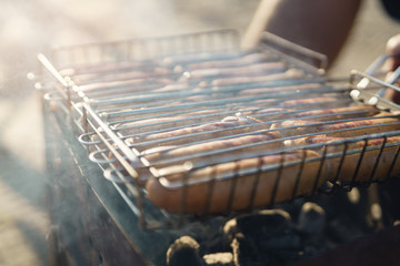 closeup shot of preparing sausages on bbq outdoors