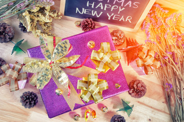 Merry Christmas and Happy New Year - present boxes with Xmas decorations