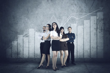 Successful multiracial people with financial graph