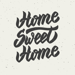 Home sweet home. Hand drawn lettering isolated on white background.