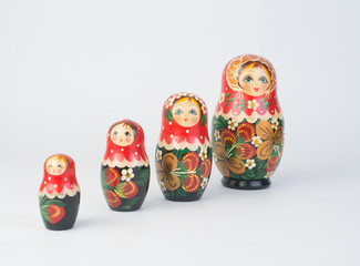Travel around the world for your colorful life .Enjoy the funny trip journey .Top view for copy space some idea your create destination .object  cute  ,  Set of matrioshka dolls on white background.