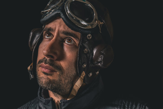 Portrait of a man with aviator helmet and goggles looking into the distance