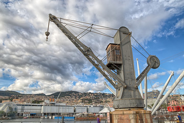 GENOA (GENOVA), AUGUST, 10, 2017 - View of an old industrial crane in the ancient port of Genoa (GEnova), Italy, under a cloudy sky.