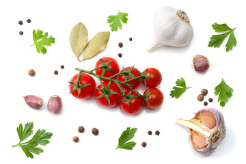 cherry tomato, garlic and spices isolated on white background. top view