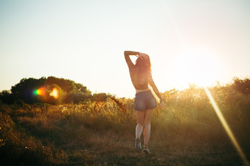 Young playful hippie woman outdoors on a summer day