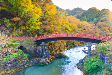 Nikko red Shinkyo bridge in autumn season.