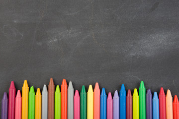 colored crayons on the blackboard