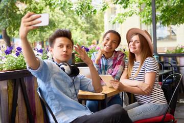 Cool Friends Taking Selfie in Cafe