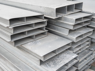 Pile steel channel for construction of a house to an outdoor site. Steel beams for the roof. Profile pipes
